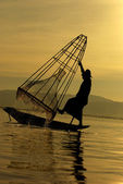 Fisherman of Inle Lake in action how to fishing, Myanmar, silhou — Stock Photo