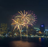 Multicolor fireworks night scene, closeup with pattaya cityscape — Stock Photo