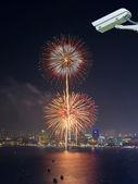 Security camera monitoring the multicolor fireworks night scene — Stock Photo