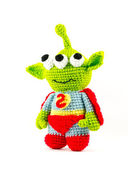 Handmade crochet green alien three eyes super hero doll on white — Stock Photo