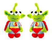 Handmade crochet green alien three eyes super hero doll on white — Stock Photo