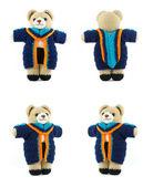 Handmade crochet teddy bear doll with graduation gown on white b — Stock Photo