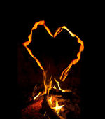 Fire flames with heart on a black background — Stock Photo