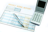 Invoice report with calculator and pen for business — Stock Photo