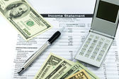 Income statement report with calculator, pen and usd money for b — Stock Photo