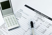 Income statement report with calculator and pen for business — Stock Photo