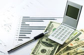 Income and outcome statement report with calculator, pen and usd — Stock Photo