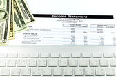 Income statement report with calculator and key broad for busine — Stock Photo