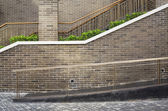 Walk way and staircase with brick wall background and texture — Stock Photo