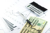 Stock graph report with calculator, pen and usd money for busine — Stock Photo