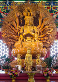 Close up Golden Wood Statue of Guan Yin with 1000 hands — Stock Photo