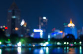 Cityscape bokeh, Blurred Photo, cityscape river view at twilight — Stock Photo