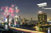Security camera monitoring the fireworks with bangkok cityscape  — Foto de Stock