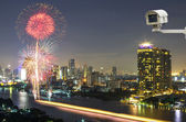 Security camera monitoring the fireworks with bangkok cityscape  — Stockfoto
