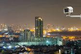 Security camera monitoring the Bangkok cityscape at twilight, wo — Stock Photo