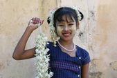 MANDALAY, MYANMAR - JANUARY 03: Unidentified Smiling Burmese girl with traditional thanaka on her face on January 03, 2011 in Mandalay, Myanmar. — Stock Photo