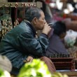 BAGAN, MYANMAR- JAN 4:An unidentified Burmese man smoking a cheroot cigar in market at bagan, Myanmar on January 4, 2011.A cheroot is a cigar made principally by dried fruits and little bit of tobacco — Stock Photo #50241483