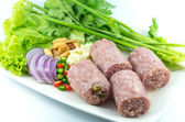 Cooked sour sausage pork with vegetable on the plate — Stock fotografie
