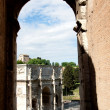 Constantine's triumphal arch through the window Colosseum    — Stock Photo