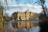 School building in in the mirror of pond in Litovel, Czech Republic — Stock Photo