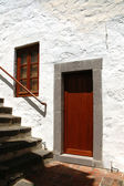 Brown door in a stone door frame — Stock Photo