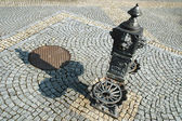 Old water well in the square — Stock Photo