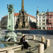 Stock Photo: OLOMOUC, CZECH REPUBLIC CIRCMAY 2005 - Unknown nun sitting on edge of fountain