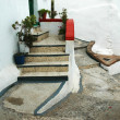 Stock Photo: Stairs to entry door in narrow alley