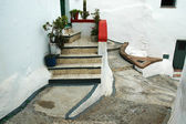 Stairs to entry door in a narrow alley — Stock Photo