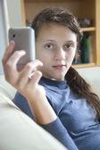Girl playiing on mobile — Stock Photo