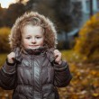 Autumn portrait of cute smiling little girl  — Stock Photo