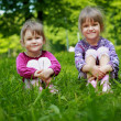 Two young smiling girls in the grass — Stock Photo