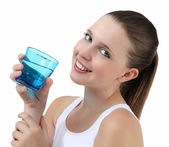 Woman drinking water from glass — Stockfoto