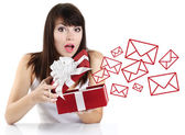 Surprised girl opening a red gift box — Foto de Stock