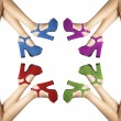 Foto de Stock  : Legs and feet of womwith colored shoes in circle