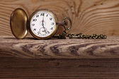 Antique clock on wood — Stockfoto