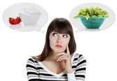 Diet, young woman choosing between fruits and sweets. weight los — Stock Photo