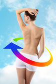 Body of woman ass and back on background of sky with colored arr — Stok fotoğraf