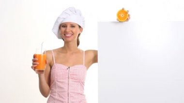 Woman who explains the diet and wellness drinking a orange juice — Stock Video