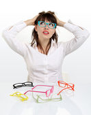 Pretty girl wearing colored glasses — Stock Photo