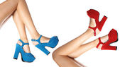 Shoes worn by female legs — Stock Photo