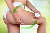 Woman applying cosmetic cream from cellulite on the buttocks in  — Stock Photo