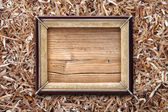 Old frame on a wooden background — Stockfoto