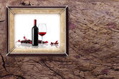 Bottle and glass of wine on wooden backgrounds — Stock fotografie