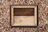 Old frame on a wooden background — Stock Photo