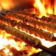 Indian kebabs cooking on barbecue — Stock Photo