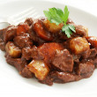 Stock Photo: Beef casserole on white plate
