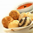 Bread roll selection with tomato soup — Stock Photo