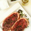 Sirloin steaks on white plate — Stockfoto