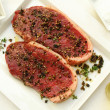 Sirloin steaks on white plate — Stock Photo